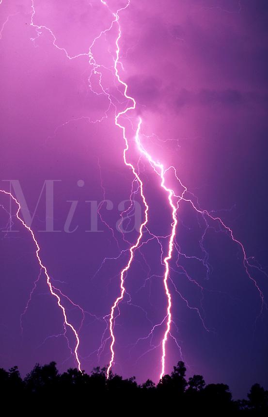 Lightning bolts strike the Earth.