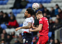 Bolton Wanderers' Josh Magennis competing with Walsall's Jon Guthrie<br /> <br /> Photographer Andrew Kearns/CameraSport<br /> <br /> Emirates FA Cup Third Round - Bolton Wanderers v Walsall - Saturday 5th January 2019 - University of Bolton Stadium - Bolton<br />  <br /> World Copyright &copy; 2019 CameraSport. All rights reserved. 43 Linden Ave. Countesthorpe. Leicester. England. LE8 5PG - Tel: +44 (0) 116 277 4147 - admin@camerasport.com - www.camerasport.com