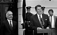 Washington, DC., USA, February 13,1984<br /> President Ronald Reagan with King Hussein II of Jordan at the South Portico of the White House at the conclusion of their meeting. Credit: Mark Reinstein/MediaPunch