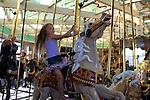 Girl on Loof Carousel, Beach Boardwalk