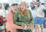 Walt Podles and Shelby Brookshire try and keep warm before the 2010 Polar Bear Plunge.