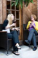 Duplin Winery employees Nicole Howard and Ann Farrior enjoy a taste of the bounty.