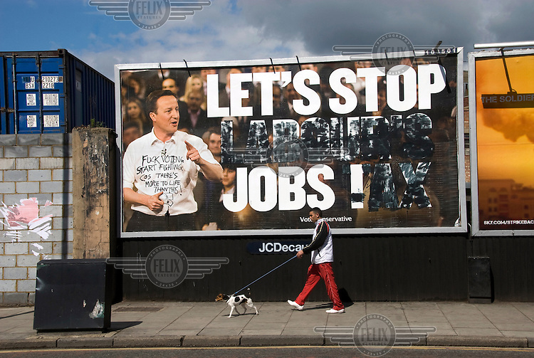 A defaced Conservative Party billboard featuring leader David Cameron on a London Borough of Hackney street, days before the general election.