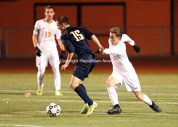 Watertown, CT- 10 November 2016-111016CM13-  Watertown's Brendan Law right, tries to get to the ball against RHAM's Jack Salan during their state tournament matchup on Thursday.     Christopher Massa Republican-American