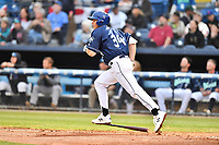 Asheville Tourists first baseman Grant Lavigne (34) runs to first base during a game against the Augusta GreenJackets at McCormick Field on April 4, 2019 in Asheville, North Carolina. The GreenJackets defeated the Tourists 9-5. (Tony Farlow/Four Seam Images)