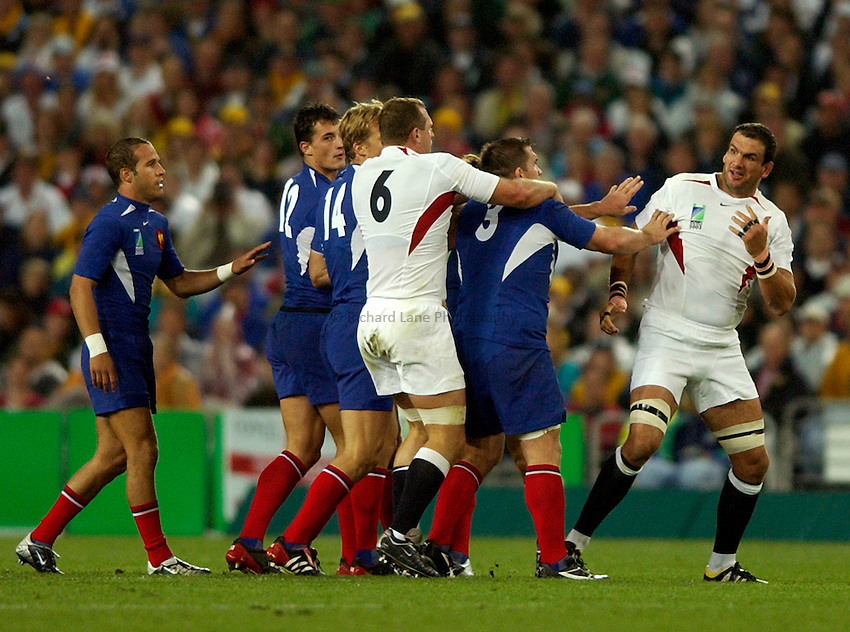Photo. Richard Lane. .France v England. Semi-final at the Telstra Stadium, Sydney. RWC 2003..16/11/2003..Martin Johnson is on the receiving end of early tension.