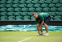 A Groundsman working on Centre Court<br /> <br /> Photographer Ashley Western/CameraSport<br /> <br /> Wimbledon Lawn Tennis Championships - Day 9 - Wednesday 12th July 2017 -  All England Lawn Tennis and Croquet Club - Wimbledon - London - England<br /> <br /> World Copyright &not;&copy; 2017 CameraSport. All rights reserved. 43 Linden Ave. Countesthorpe. Leicester. England. LE8 5PG - Tel: +44 (0) 116 277 4147 - admin@camerasport.com - www.camerasport.com
