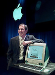 **FILE**Apple Computers Inc. chief executive Steve Jobs unveils the the new iMac computer in a Cupertino, Calif. file photo from  May 6, 1998. Apple Computer Inc., the first major PC maker to convert to flat-panel displays, has completely rid itself of bulky cathode ray tube (CRT) monitors. The move is part of an industrywide trend both in computers and televisions toward the use of more popular, liquid-crystal display, or LCD, monitors, which are sleeker and more power-efficient than its older CRT counterparts.  (AP Photo/Paul Sakuma, file)