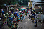 BUKAVU, DEMOCRATIC REPUBLIC OF CONGO - OCTOBER 30: Unidentified women and children walks to retire on a hospital ground as the sun goes down on October 30, 2007 at Panzi hospital outside Bukavu, DRC. Many of these women has been raped and abused by rebels and government soldiers. Many of the children are a result of rape. About 10 women and girls show up at the hospital every day and Dr. Denis Mukwege, a gynecologist and his staff does up to 20 reconstructive operations every day. He often has to perform complicated surgery to reproductive and digestive parts of the women. The DRC conflict has seen an unprecedented high rate of rape and sexual abuse of women. The culprits are both different rebel groups and government soldiers and very few are punished. About 27,000 sexual assaults were reported in South Kivu province alone in 2006, according to the United Nations. (Photo by Per-Anders Pettersson)