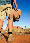 An outback guide looks toward Uluru (Ayers Rock).  Uluru-Kata Tjuta National Park, Northern Territory, AUSTRALIA.