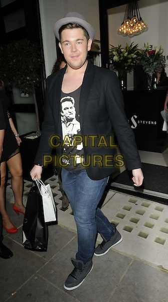 Craig Colton.attended the Jamie Stevens 1st London salon launch party, Jamie Stevens Salon, Russell Gardens, London, England, 30th March 2012..full length hat black t-shirt suit blazer jacket jeans hi-top trainers grey gray bag .CAP/CAN.©Can Nguyen/Capital Pictures.