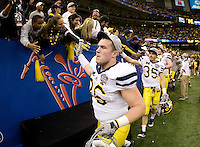 Zac Johnson of Michigan celebrates with the fans after winning Sugar Bowl game against Virginia Tech at Mercedes-Benz SuperDome in New Orleans, Louisiana on January 3rd, 2012.  Michigan defeated Virginia Tech, 23-20 in first overtime.