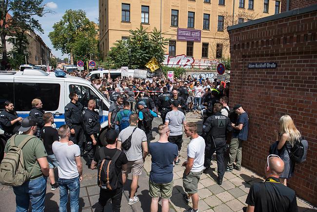 """Am Samstag den 20 Juli 2019 versuchten in Halle an der Saale ca. 200 Mitglieder und Anhaenger der rechtsextremen """"Identitaeren Bewegung"""", IB, eine Demonstration durchzufuehren. Sie versammelten sich dafuer vor dem Haus der IB in der Adam-Kuckhoff-Straße 16. Aufgrund von Gegenprotesten konnten die Rechtsextremen jedoch nicht marschieren, da alle Straßen um ihr Haus von Gegendemonstranten blockiert wurden.<br /> 20.7.2019, Berlin<br /> Copyright: Christian-Ditsch.de<br /> [Inhaltsveraendernde Manipulation des Fotos nur nach ausdruecklicher Genehmigung des Fotografen. Vereinbarungen ueber Abtretung von Persoenlichkeitsrechten/Model Release der abgebildeten Person/Personen liegen nicht vor. NO MODEL RELEASE! Nur fuer Redaktionelle Zwecke. Don't publish without copyright Christian-Ditsch.de, Veroeffentlichung nur mit Fotografennennung, sowie gegen Honorar, MwSt. und Beleg. Konto: I N G - D i B a, IBAN DE58500105175400192269, BIC INGDDEFFXXX, Kontakt: post@christian-ditsch.de<br /> Bei der Bearbeitung der Dateiinformationen darf die Urheberkennzeichnung in den EXIF- und  IPTC-Daten nicht entfernt werden, diese sind in digitalen Medien nach §95c UrhG rechtlich geschuetzt. Der Urhebervermerk wird gemaess §13 UrhG verlangt.]"""