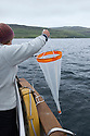 Plankton net being used to urvey marine fauna. Isle of Mull, Scotland, UK, June.