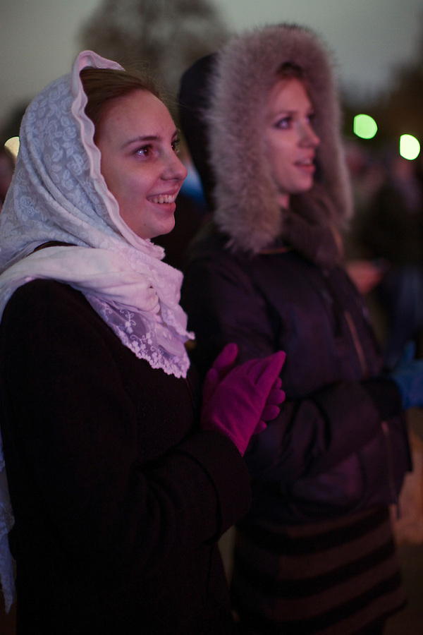 Moscow, Russia, 28/10/2011..Two woman watch the gala reopening of the Bolshoi Theatre on giant video screens erected in Ploschad Revolutsii opposite the theatre, which had been closed since 2005 for reconstruction work that cost some $700 million.