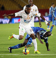 BOGOTA -COLOMBIA. 19-04-2014. Modeste M´bami (Der) de Millonarios  disputa el balon contra Jhon Hurtado del Deportes Tolima  partido por la fecha 18 de La liga Postobon 1 disputado en el estadio Nemesio Camacho El Campin. /    Modeste M´bami  (R) of Millonarios  dispute the balloon against Jhon Hurtado of  Deportes Tolima  match date 18 The Postobon one league match at the Estadio Nemesio Camacho El Campin. . Photo: VizzorImage/ Felipe Caicedo / Staff