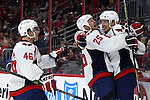 04 December 2014: Washington's Jay Beagle (right) celebrates his goal with Jason Chimera (25) and Michael Latta (46). The Carolina Hurricanes played the Washington Capitals at the PNC Arena in Raleigh, North Carolina in a 2014-15 National Hockey League game. Washington won the game 2-1.
