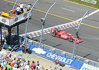 Jun. 22, 2008; Newton, IA, USA; IRL driver Dan Wheldon takes the checkered flag to win the Iowa Corn Indy 250 at the Iowa Speedway. Mandatory Credit: Mark J. Rebilas-