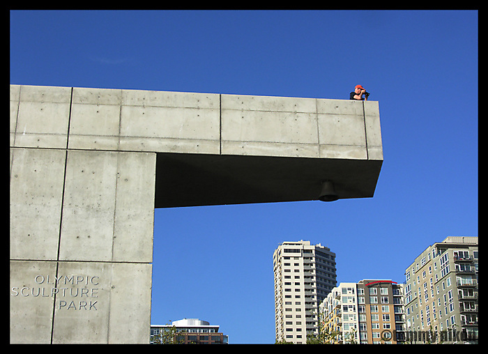 Solo photographer on cantilevered architectural element at Olympic Sculpture Park