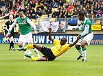 Nederland, Kerkrade, 2 november 2008 .Eredivisie .Seizoen 2008-2009 .Roda JC-Feyenoord (4-0) .Sekou Cisse (m) van Roda JC en Karim El Ahmadi (l) en Andre Bahia strijden om de bal.