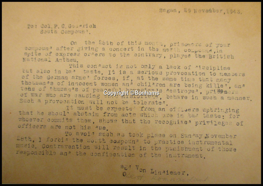 BNPS.co.uk (01202 558833)<br /> Pic: Bonhams/BNPS<br /> <br /> A missive from the camp commandant berating a British general after his men broke camp rules to play the British national anthem. <br /> <br /> Tell-tale illustrations of British airmen plotting the famous Great Escape drawn by a prisoner of war at huge risk have come to light.<br /> <br /> The watercolour paintings were kept in a wartime scrapbook by Flight Lieutenant Archibald Sulston, a keen artist who drew and painted life in the PoW - including obvious evidence of a tunnel being dug.<br /> <br /> The album is being sold at auction for &pound;20,000.