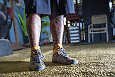 USA, Oahu, Hawaii, a boxers shoes and tattooed legs at a boxing gym in Honolulu