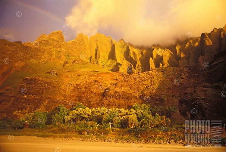 Rainbow over Kalalau valley at sunset, Na Pali coastline of Kauai