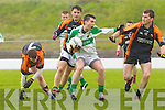 Stephen Lonergan of Ballydonoghue is sourrounded by Sneem/Derrynane players in the Credit Union County League Division 5 last Sunday in Ballydonoghue.