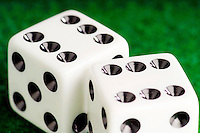 Close up of dice on felt showing double six