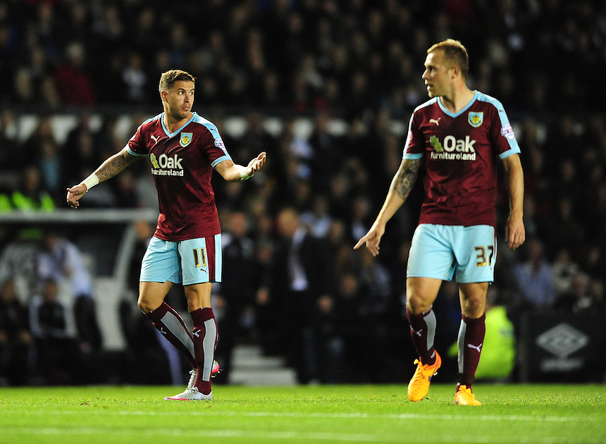 Burnley's Michael Kightly, left, and Burnley's Scott Arfield<br /> <br /> Photographer Chris Vaughan/CameraSport<br /> <br /> Football - The Football League Sky Bet Championship - Derby County v Burnley - Monday 21st September 2015 - iPro Stadium - Derby<br /> <br /> &copy; CameraSport - 43 Linden Ave. Countesthorpe. Leicester. England. LE8 5PG - Tel: +44 (0) 116 277 4147 - admin@camerasport.com - www.camerasport.com