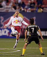 Columbus Crew midfielder (7) Guillermo Barros Schelotto watches as NY Red Bulls midfielder (13) Clint Mathis plays the ball at Giants Stadium, East Rutherford, NJ, on May 19, 2007.