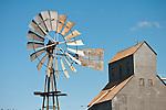 Metal Fairbank-Morse Steel Eclipse metal windmill, grain elevator, Pine City, Wash.