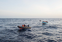 Sea Watch-2.<br /> Die Sea Watch-2 bei ihrer 13. SAR-Mission vor der libyschen Kueste.<br /> Im Bild: Gefluechtete werden zur Sea Watch-2 gebracht.<br /> 21.10.2016, Mediterranean Sea<br /> Copyright: Christian-Ditsch.de<br /> [Inhaltsveraendernde Manipulation des Fotos nur nach ausdruecklicher Genehmigung des Fotografen. Vereinbarungen ueber Abtretung von Persoenlichkeitsrechten/Model Release der abgebildeten Person/Personen liegen nicht vor. NO MODEL RELEASE! Nur fuer Redaktionelle Zwecke. Don't publish without copyright Christian-Ditsch.de, Veroeffentlichung nur mit Fotografennennung, sowie gegen Honorar, MwSt. und Beleg. Konto: I N G - D i B a, IBAN DE58500105175400192269, BIC INGDDEFFXXX, Kontakt: post@christian-ditsch.de<br /> Bei der Bearbeitung der Dateiinformationen darf die Urheberkennzeichnung in den EXIF- und  IPTC-Daten nicht entfernt werden, diese sind in digitalen Medien nach §95c UrhG rechtlich geschuetzt. Der Urhebervermerk wird gemaess §13 UrhG verlangt.]