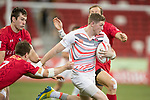 Ruaridh McConnochie of England runs with the ball while Canadian players try to stop him during the match Canada vs England, Day 2 of the HSBC Singapore Rugby Sevens as part of the World Rugby HSBC World Rugby Sevens Series 2016-17 at the National Stadium on 16 April 2017 in Singapore. Photo by Victor Fraile / Power Sport Images