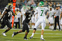 1 September 2011:  FIU's Winston Fraser (34) pressures North Texas' Derek Thompson (7) in the first half as the FIU Golden Panthers defeated the University of North Texas, 41-16, at University Park Stadium in Miami, Florida.