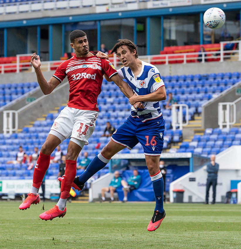 Middlesbrough's Ashley Fletcher (left) scores his side's first goal as he battles with Reading's Tom McIntyre (right) <br /> <br /> Photographer David Horton/CameraSport<br /> <br /> The EFL Sky Bet Championship - Reading v Middlesbrough - Tuesday July 14th 2020 - Madejski Stadium - Reading<br /> <br /> World Copyright © 2020 CameraSport. All rights reserved. 43 Linden Ave. Countesthorpe. Leicester. England. LE8 5PG - Tel: +44 (0) 116 277 4147 - admin@camerasport.com - www.camerasport.com