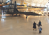 "Chantilly, Virginia - December 5, 2003 -- A television crew walks past a Lockheed SR-71A ""Blackbird"" aircraft at the Steven F. Udvar-Hazy Center in Chantilly, Virginia on December 5, 2003.  The SR-71 flew higher and faster than any other aircraft.  It was used for reconnaissance missions during the Cold War and thereafter.  This Blackbird accrued about 2,800 hours of flying time.  It set the a speed record, flying from Los Angeles, California to Washington Dulles International Airport in Chantilly, Virginia on March 6, 1990.  It completed the flight in 1 hour, 4 minutes and 20 seconds averaging 2,124 miles (3,418 kilometers) per hour..Credit: Ron Sachs / CNP.(RESTRICTION: NO New York or New Jersey Newspapers or newspapers within a 75 mile radius of New York City)"
