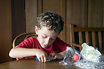 Berkeley CA Boy, five-years-old, engrossed in creating with soft clay  MR