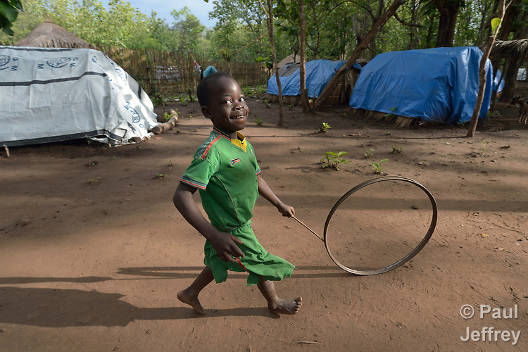 A boy pushes a wheel in a camp for for than 5,000 displaced people in Riimenze, in South Sudan's Gbudwe State, what was formerly Western Equatoria. Families here were displaced at the beginning of 2017, as fighting between government soldiers and rebels escalated.<br /> <br /> Two Catholic groups, Caritas Austria and Solidarity with South Sudan, have played key roles in assuring that the displaced families here have food, shelter and water.