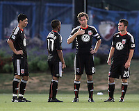 Carey Talley #8 of D.C. United talks to teammates during a US Open Cup match against the Harrisburg City Islanders at the Maryland Soccerplex on July 21 2010, in Boyds, Maryland. United won 2-0.