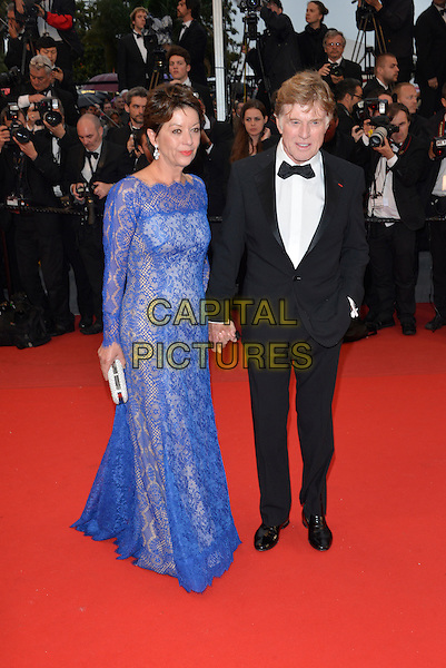 Sibylle Szaggars, Robert Redford .'All is Lost' premiere at 66th Cannes Film Festival, France..22nd May 2013.full length blue black dress lace tuxedo white shirt married husband wife holding hands.CAP/PL.©Phil Loftus/Capital Pictures.