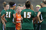 12 September 2013: Miami head coach Mary-Frances Monroe (in orange) talks to her team. The Duke University Blue Devils hosted the University of Miami Hurricanes at Koskinen Stadium in Durham, NC in a 2013 NCAA Division I Women's Soccer match. Duke won the game 3-0.
