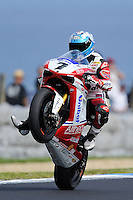 PHILLIP ISLAND, 26 FEBRUARY - Carlos Checa (ESP) riding the Ducati 1098R (7) of the Althea Racing Team performs the crowd after qualifying in first place for round one of the 2011 FIM Superbike World Championship at Phillip Island, Australia. (Photo Sydney Low / syd-low.com)