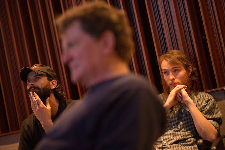 Willie Perkins (Left) and Caleb Brown listen to a recently recorded track with Eddie Ashworth (Center).
