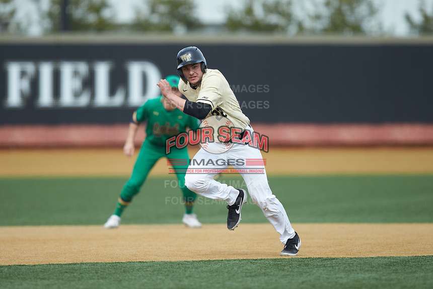 Michael Ludowig (22) of the Wake Forest Demon Deacons takes off for third base during the game against the Notre Dame Fighting Irish at David F. Couch Ballpark on March 10, 2019 in  Winston-Salem, North Carolina. The Demon Deacons defeated the Fighting Irish 7-4 in game one of a double-header.  (Brian Westerholt/Four Seam Images)