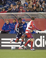 New England Revolution forward/midfielder Kenny Mansally (29) brings ball down wing. The New England Revolution defeated FC Dallas, 2-1, at Gillette Stadium on April 4, 2009. Photo by Andrew Katsampes /isiphotos.com
