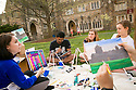 DuArts President Kelsey Graywill, senior, leads a monthly painting workshop with fellow students, from left, Adarsh Nellore, junior, Devin Buckley, PhD grad student in English, Logan Smith, sophomore, and Christine Wei, senior, foreground right, on the residential quad where they were painting Kilgo's Princess Tower. The workshop is offered on the second Friday of each month.