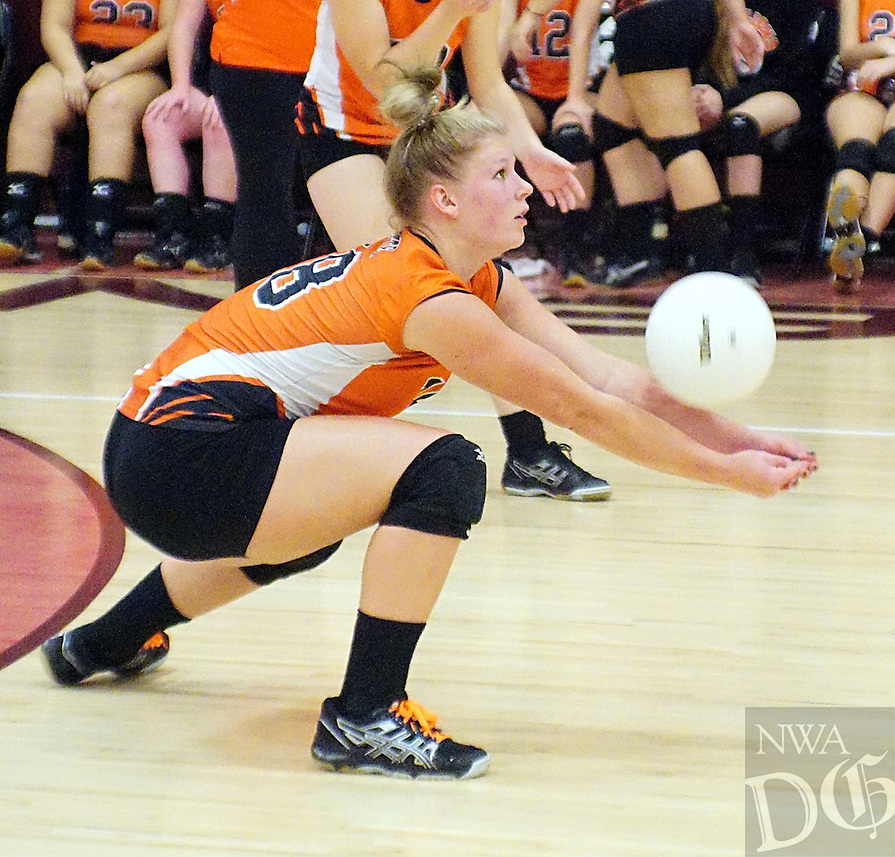 Photo by Randy Moll<br /> Stephanie Pinter, Gravette junior, keeps a serve from dropping in during play against Gentry at Gentry High School on Tuesday, Sept. 22, 2015.