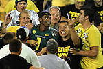 10/02/10-- Oregon quarterback Darron Thomas is surrounded by Duck fans after defeating  Stanford 52-31 at Autzen Stadium in Eugene, Or..Photo by Jaime Valdez......