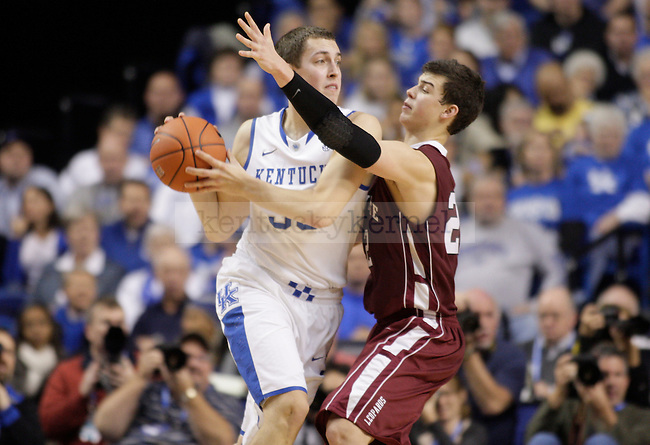 UK forward Kyle Wiltjer looks to pass the ball against Lafayette forward Alan Flannigan during the first half of the UK men's basketball game vs. Lafayette at Rupp Arena in Lexington, Ky., on Friday, November 16, 2012. Photo by Tessa Lighty | Staff